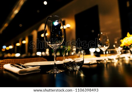 Luxury table settings for fine dining with and glassware, beautiful blurred  background. For events, weddings. #1106398493