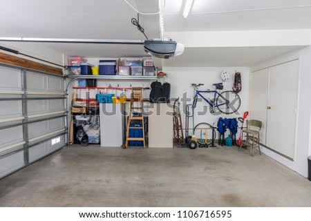 Organized clean suburban residential two car garage with tools, file cabinets and sports equipment.   #1106716595