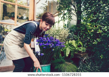 Japanese woman working in a flower shop #1106728355