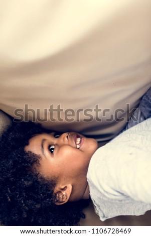 Little kid under a duvet #1106728469
