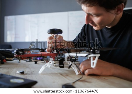 Photo of engineer fixing square copter at table #1106764478
