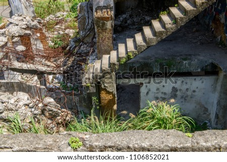 Old collapsing staircase without railings and supports #1106852021