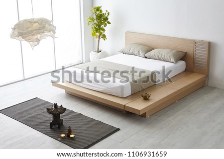 Modern peaceful Bedroom. zen style bedroom. Peaceful and serene bedroom. Wood bed with oriental object.led bed. japanese style bedroom. #1106931659