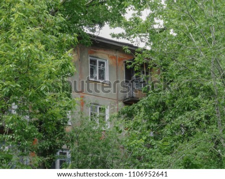 Soviet apartment building. Apartment block. Soviet architecture. Green trees. Thickets. Concrete apartment building #1106952641