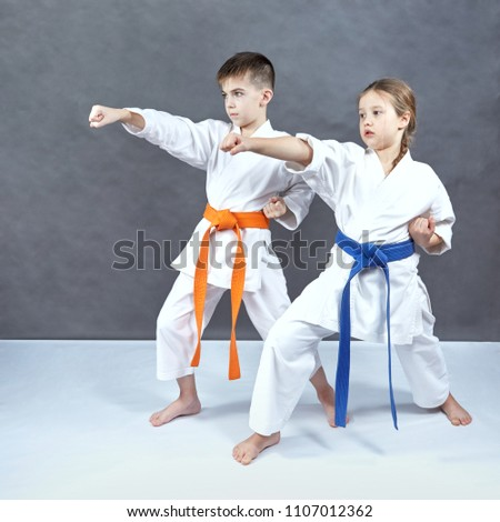 Boy and girl in karategi hit with a hand #1107012362