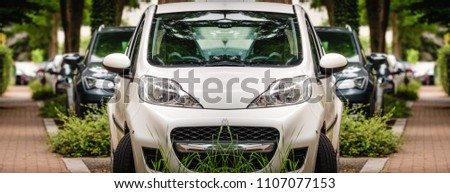 Row of modern cars parked on the street in calm green neighborhood - abstract composite image #1107077153