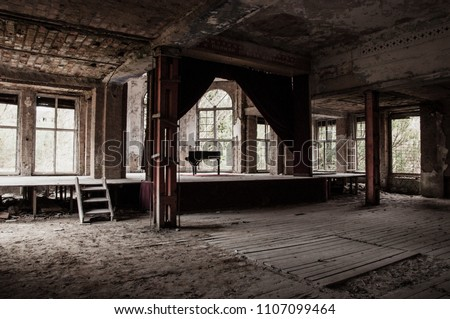 abandoned old german theater - destroyed piano on stage - scary haunted old house #1107099464