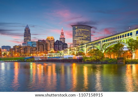 Cleveland, Ohio, USA downtown city skyline on the Cuyahoga River at twilight.