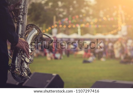 jazz musician playing outdoor concert #1107297416
