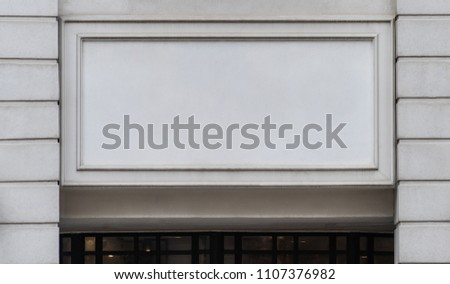 Blank Empty Concrete Signage space on building entrance for Shop and Business square Sign billboard mock up used.