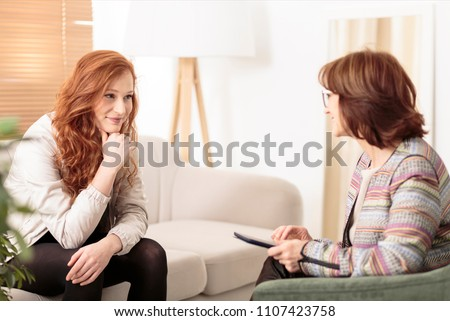 Smiling woman talking to a wellness coach to find motivation to achieve physical health goals #1107423758