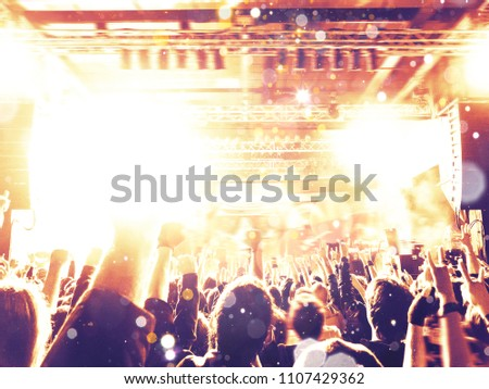 Concert hall with a big stage and many fans #1107429362