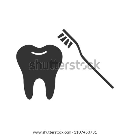 Correct teeth brushing glyph icon. Silhouette symbol. Tooth with toothbrush. Negative space. Raster isolated illustration