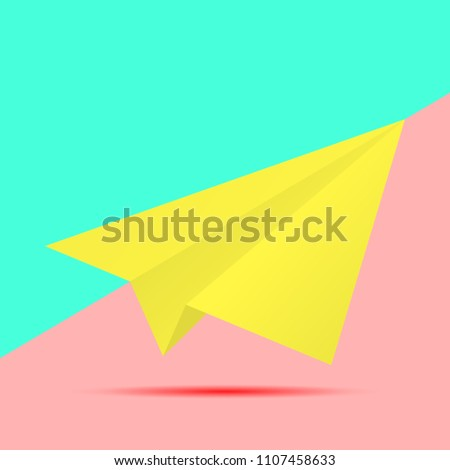 yellow paper plane icon with shadow on pink and blue background. fashion flat lay concept