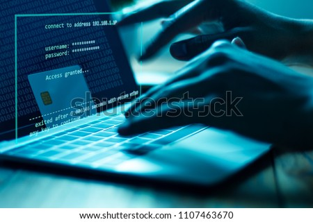 The concept of credit card theft. Hackers with credit cards on laptops use these data for unauthorized shopping. Unauthorized payments from credit card owners. In the hacker's secret office #1107463670