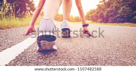 Start of people  running on street,with sunset light.Goal of Success #1107482588