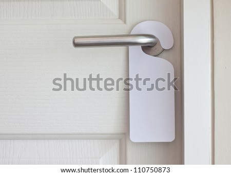 Empty label on a door handle for your text