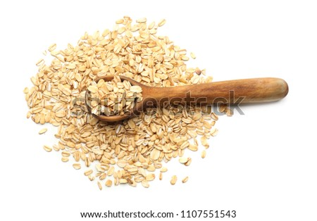 Spoon with raw oatmeal on white background #1107551543