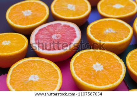 oranges cut into a color texture #1107587054