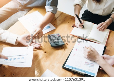 Professional investor and financial meeting present time. Young business team working with new startup project in office room present marketing strategies plan and Calculate revenue #1107631391