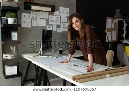 Smiling businesswoman in her office #1107695867