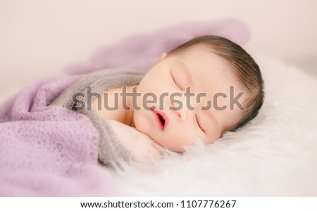 New born baby lying on a soft blanket. Cute  new born baby. #1107776267