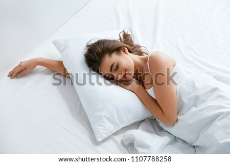 Pillows. Woman Resting On White Pillow Sleeping In Bed #1107788258