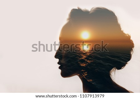 Psychology concept. Sunrise and dreamer woman silhouette. Royalty-Free Stock Photo #1107913979