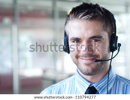 portrait of a handsome young businessman outside #110794277