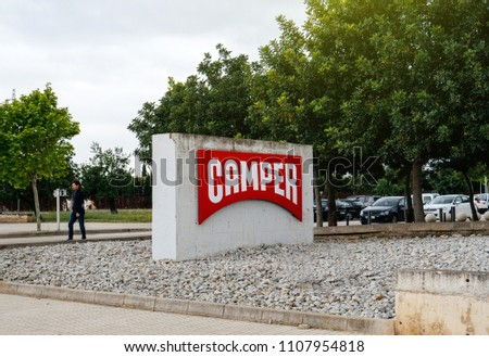INCA, PALMA DE MALLORCA, SPAIN - MAY 8, 2018: Red Camper logotype on the shoe factory headquarter in Inca with logotype on totem. Camer is a footwear company with headquarters in Mallorca, Spain #1107954818