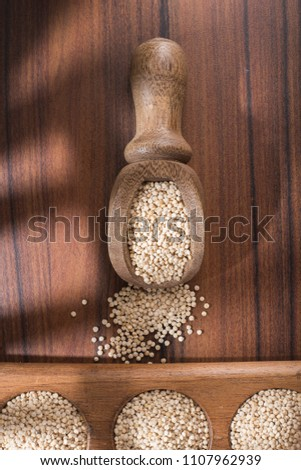 quinoa beans in bowl on rustic wooden background #1107962939