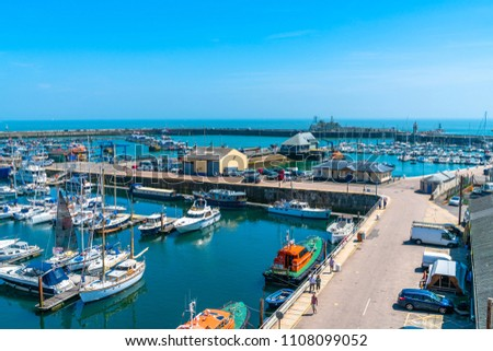 RAMSGATE, KENT, UK - JUNE 03, 2018: Ramsgate Port is a harbour run by the local authority - Thanet District Council. It serves cross-Channel freight traffic and smaller working and pleasure craft. #1108099052