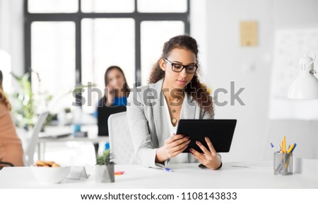 business, technology and people concept - african american businesswoman with tablet pc computer working at office #1108143833