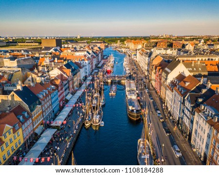 Copenhagen, Denmark Nyhavn New Harbour canal and entertainment district. The canal harbours many historical wooden ships. Aerial view from the top #1108184288