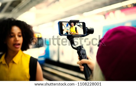 Young woman traveling and vlogging #1108228001
