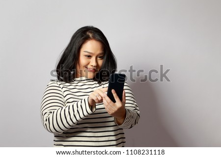 The Asian woman on the white background.