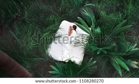 A hidden place. Sleeping woman in deep jungle forest lies on airbed,View from above #1108280270