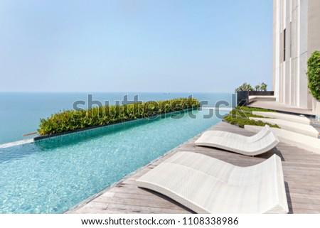 Pattaya/Thailand - Mar 1 2018 : Pool swimming on top condominium building #1108338986