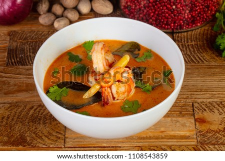 Delicious Tom Yum soup with herbs #1108543859