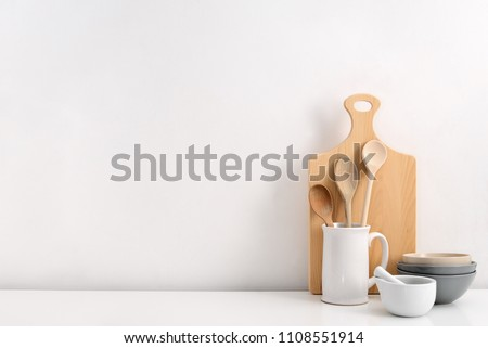 Kitchen utensils background with a blank space for a text, home kitchen decor concept, front view Royalty-Free Stock Photo #1108551914