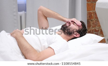 Headache, Depression, Restless Beard Man Awaking from Sleep #1108554845