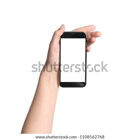 Young woman holding mobile phone with blank screen in hand on white background #1108562768