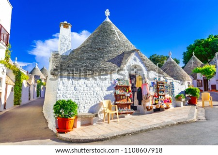 Alberobello, Puglia, Italy: Typical houses built with dry stone walls and conical roofs of the Trulli, in a beautiful day, Apulia #1108607918