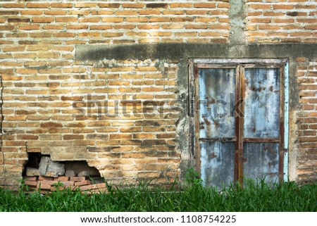 Zinc gate with old bricks wall and grass background for wallpaper decoration #1108754225