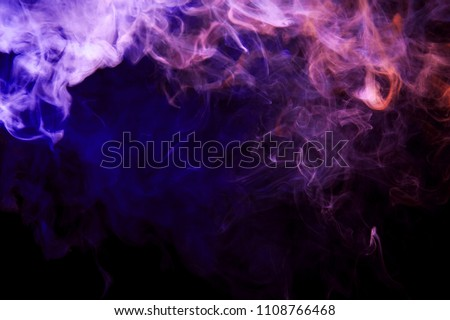 Thickpink and purple smoke on a black isolated background. Background from the smoke of vape