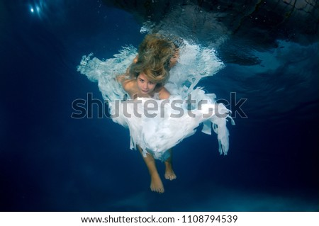 Young beautiful woman in the image of an angel underwater #1108794539