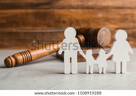Family figure and gavel on table. Family law concept #1108919288