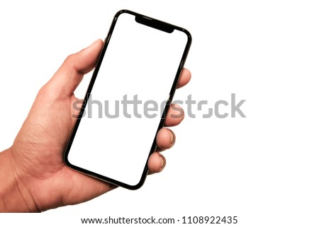 Hand holding, New version of black slim smartphone similar to iphone x with blank white screen from Apple generation 10 , Front mockup model similar to iPhonex , Background of digital economy. #1108922435