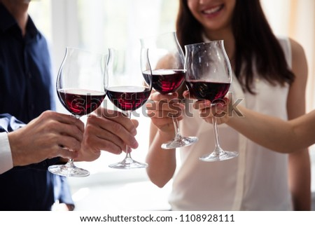 Close-up Of Friends Toasting Wineglasses At Party #1108928111