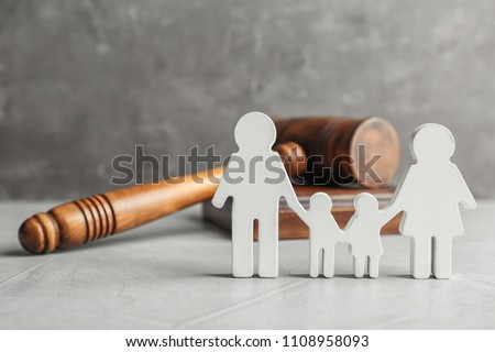 Family figure and gavel on table. Family law concept #1108958093